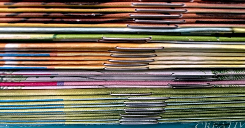 stack of think spined books