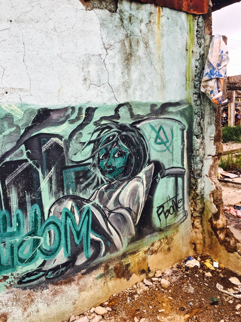 street art mural of a girl on the streets of the Philippines