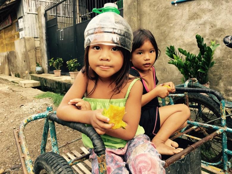 kids eating mangos