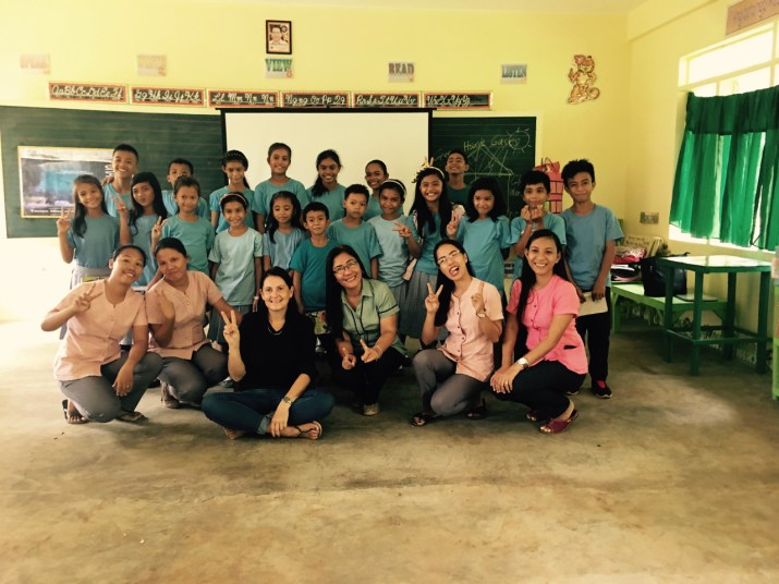 Melinda Irvine with some of the teachers, top students and the Principal of the Tanza Elementary School.