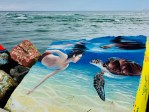 mural of boy and sea turtle