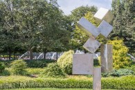 "David Smith's ""Cubi XI"" in another area of the National Sculpture Garden"
