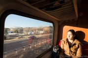 On the train to Albuquerque, the window light frames both the woman (who later chatted with us) and the view to the highway.