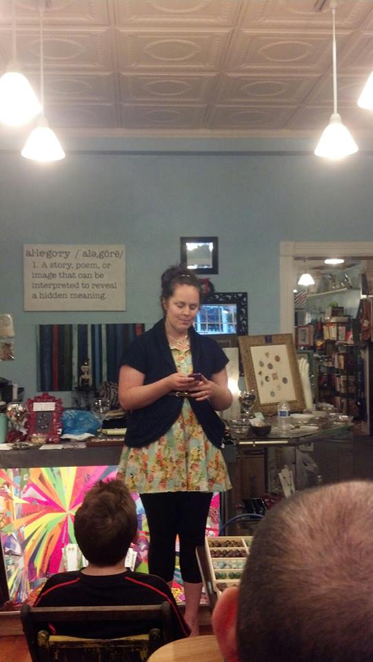 "Suzannah Paul, who writes the blog, ""The Smitten Word,"" reads us a post on her phone."