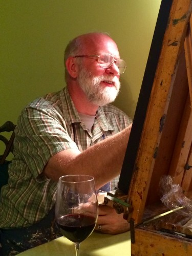 Mike Chambers painting at the kitchen table