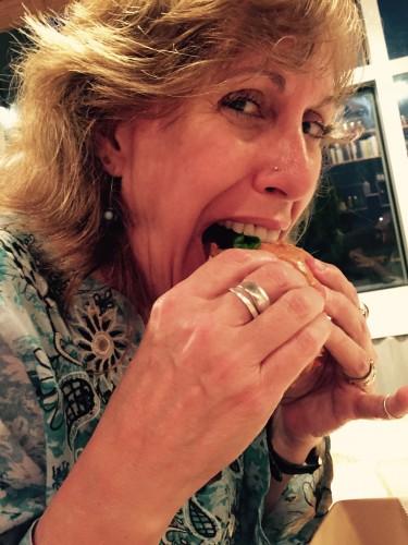 Melissa eats a Kim chi burger