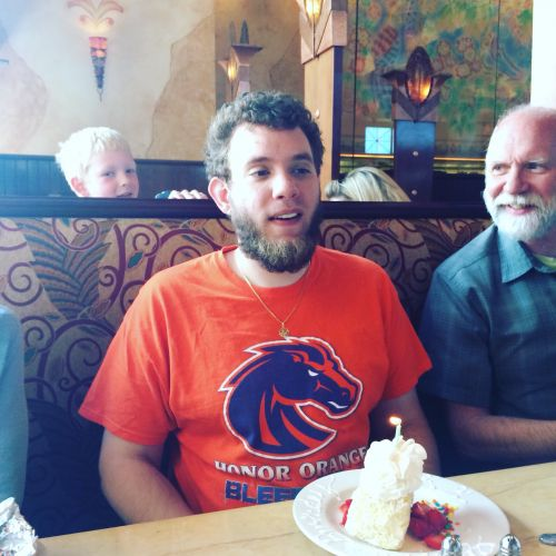 Logan, Mike and a photo bomber at Cheesecake Factory