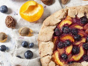 wholemeal french galette with fruits sliced apricots peaches and blueberries