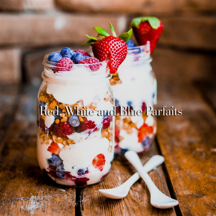 Granola Parfait with yogurt and berries on rustic background
