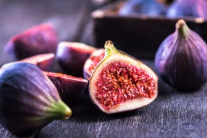 Whole and cut fresh vibrant figs fruit