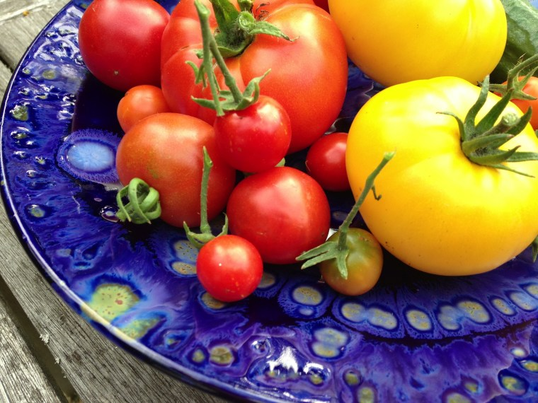 My homegrown tomatoes stashed in a handmade piece of pottery from Beaumont Pottery in Maryland.