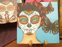 Paintings from John S. Huerta Arte Studio were a popular place for spectators during the event.