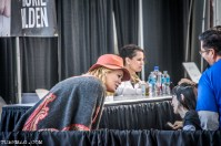 Laurie Holden aka. Andrea from The Walking Dead walks from behind the table to greet a fan in a wheelchair