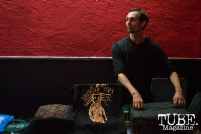 Buddy Hale of Separate Spines setting up the merchandise at Cafe Colonial in Sacramento, CA. August 2015. Photo Alejandro Montaño