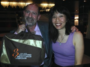 "Steve Steinbock & me, ""Melissa Yi."" The bag is medical swag because Mrs. Steinbock is a radiation oncologist who helped take care of Stephen King. And Steve interviewed Stephen King for Ellery Queen. I move among royalty now, people. Kings and Queens."