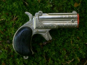 A Derringer. Not a knife. Who'd have thunk it?