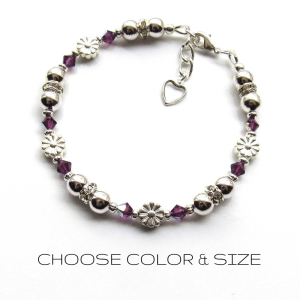 -girls silver birthstone bracelet with daisy flower charms
