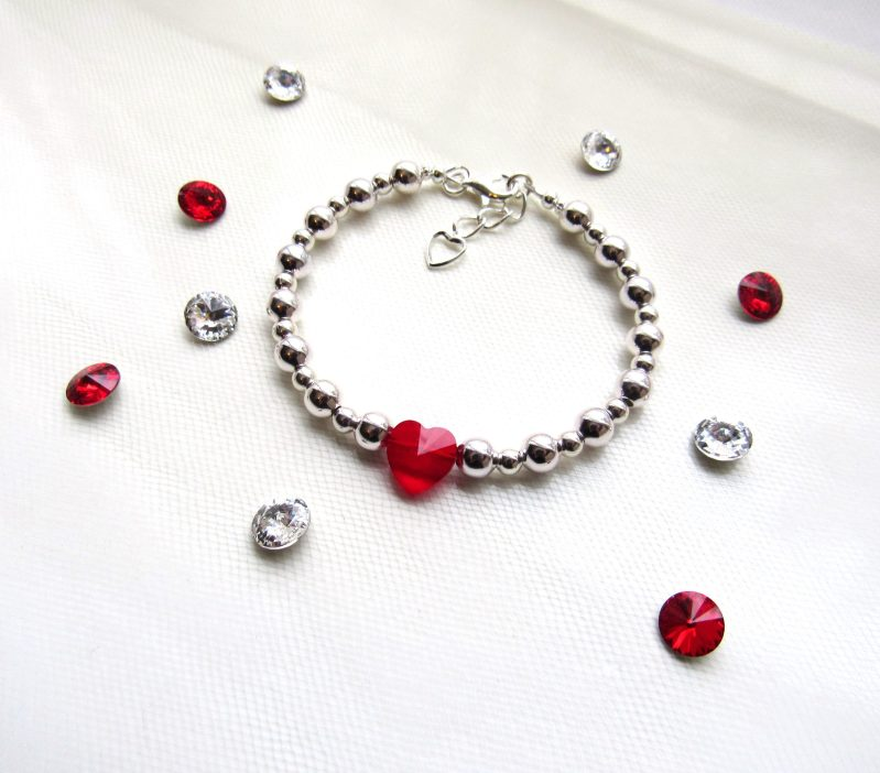 silver beaded bracelet with red heart crystal