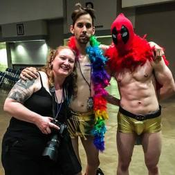 Melodie posing with Rocky from Transylvanian Lip Treatment and a costumed fan while covering the Rocky Horror Picture Show at Indy Comic Con in Indianapolis, Indiana in April 2017