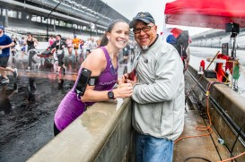 Friends and family cheer participants on while they enjoy their lap around the Indianapolis Motor Speedway despite the rain during the Annual OneAmerica 500 Festival Mini-Marathon on Saturday, May 4, 2019.