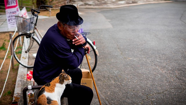 Old Himalayan Man with his cat, Story on Art and Artists