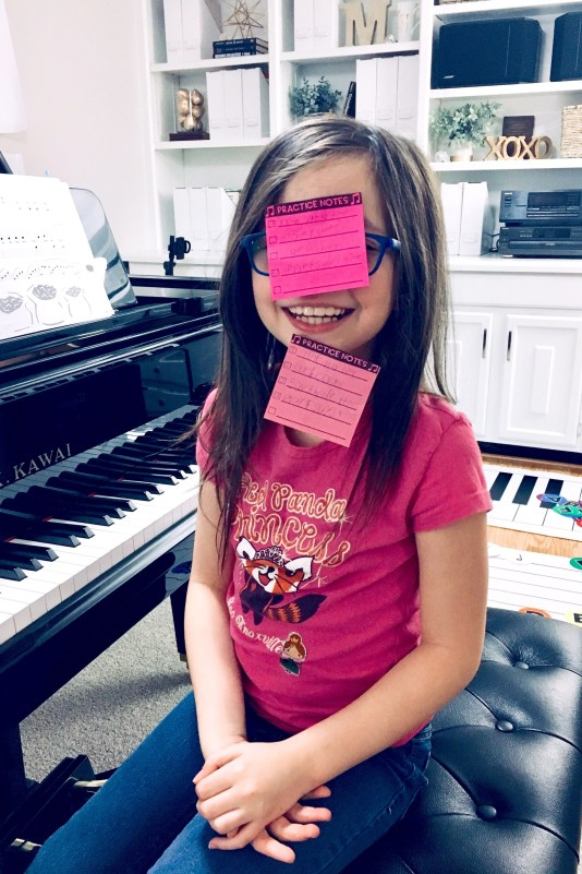piano student with practice sticky notes