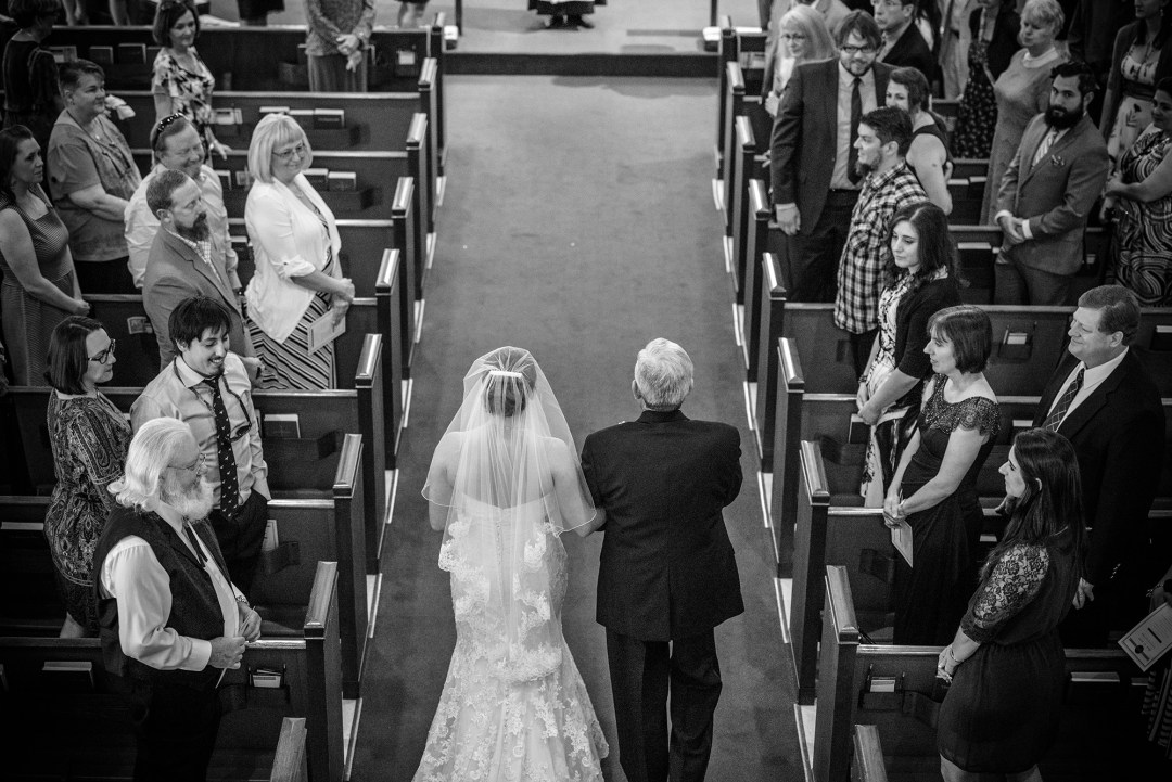 Houston Curuch Wedding Photographer Melonhead Photo black and white walking down the isle from above