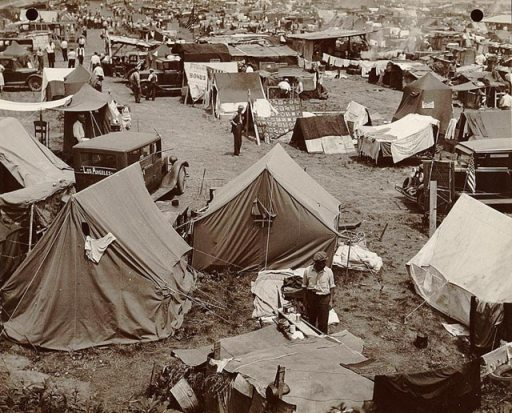 an image of a Dust Bowl/Great Depression camp of refugees and their tents