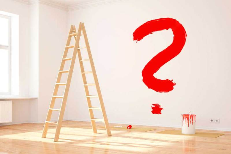 Big Red Question Mark on the Interior Wall of an Office while Renovating