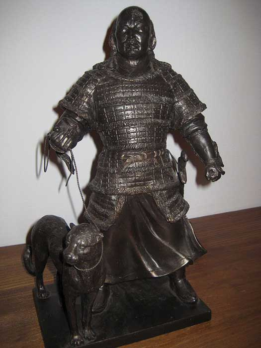 Statue of an armored Mongol warrior with a cheetah