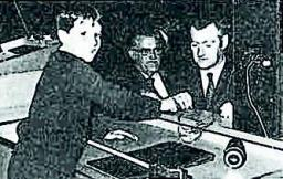 Figure 6. Dr E C Potter assisted by his son Keith in 1971 re-enacting P F Thompson's experiment showing the existence of a passive film on stainless steel (Potter, 1972).