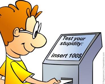 Man puts credit card into terminal.