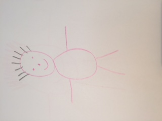 This is a hand drawn picture of a baby. It is simple, with stick arms and legs.