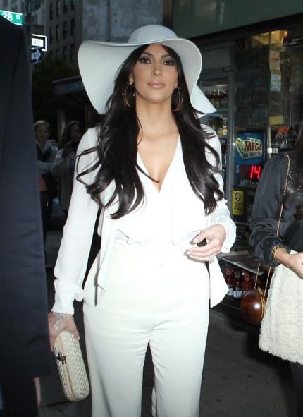 kim-kardashian-white-hat-pantsuit-10072011-lead-430x591
