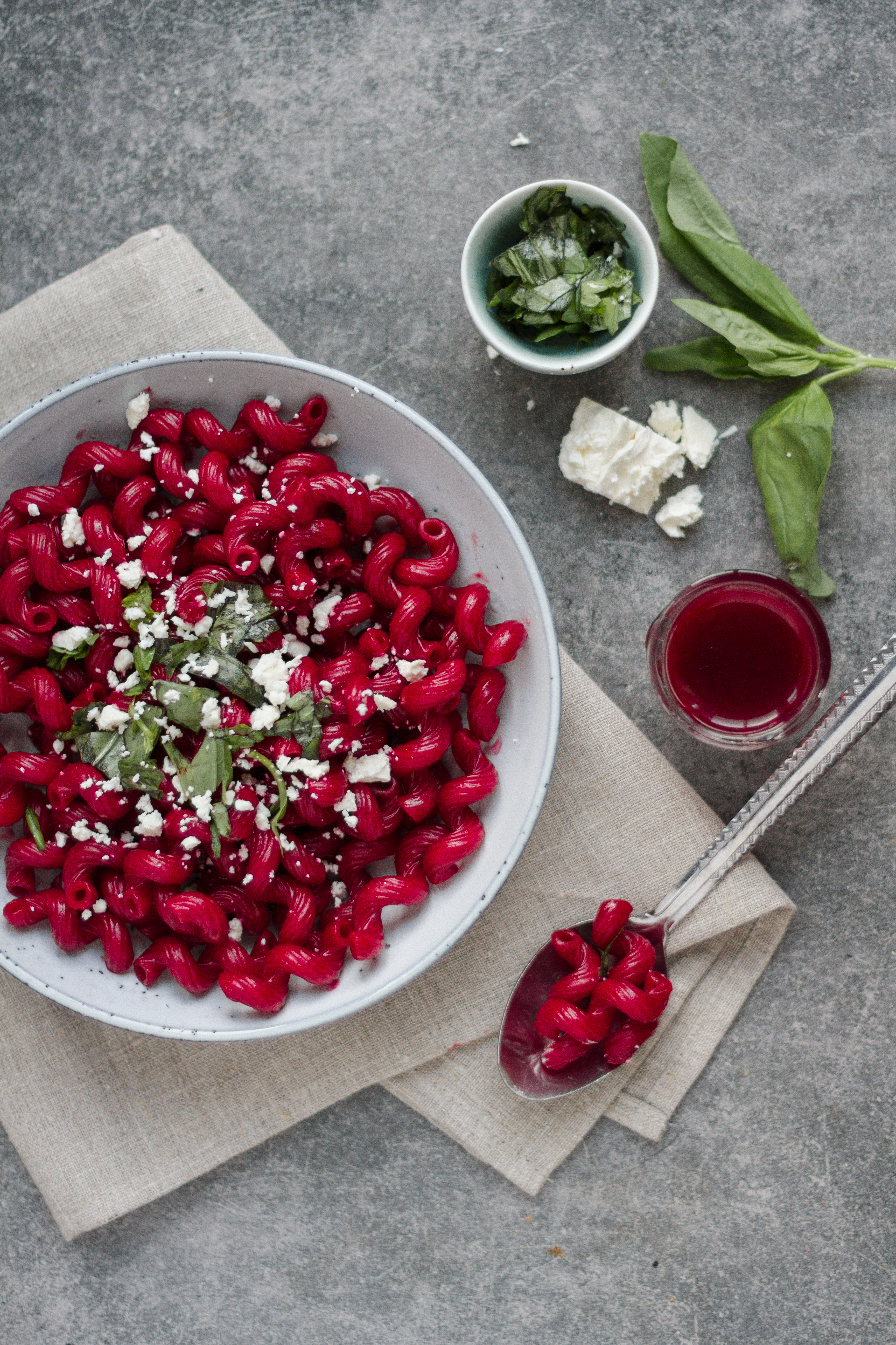 Blood red beetroot pasta salad - a delicious vegan halloween pasta recipe, and generally great vegan halloween recipe. With basil and Vegan feta