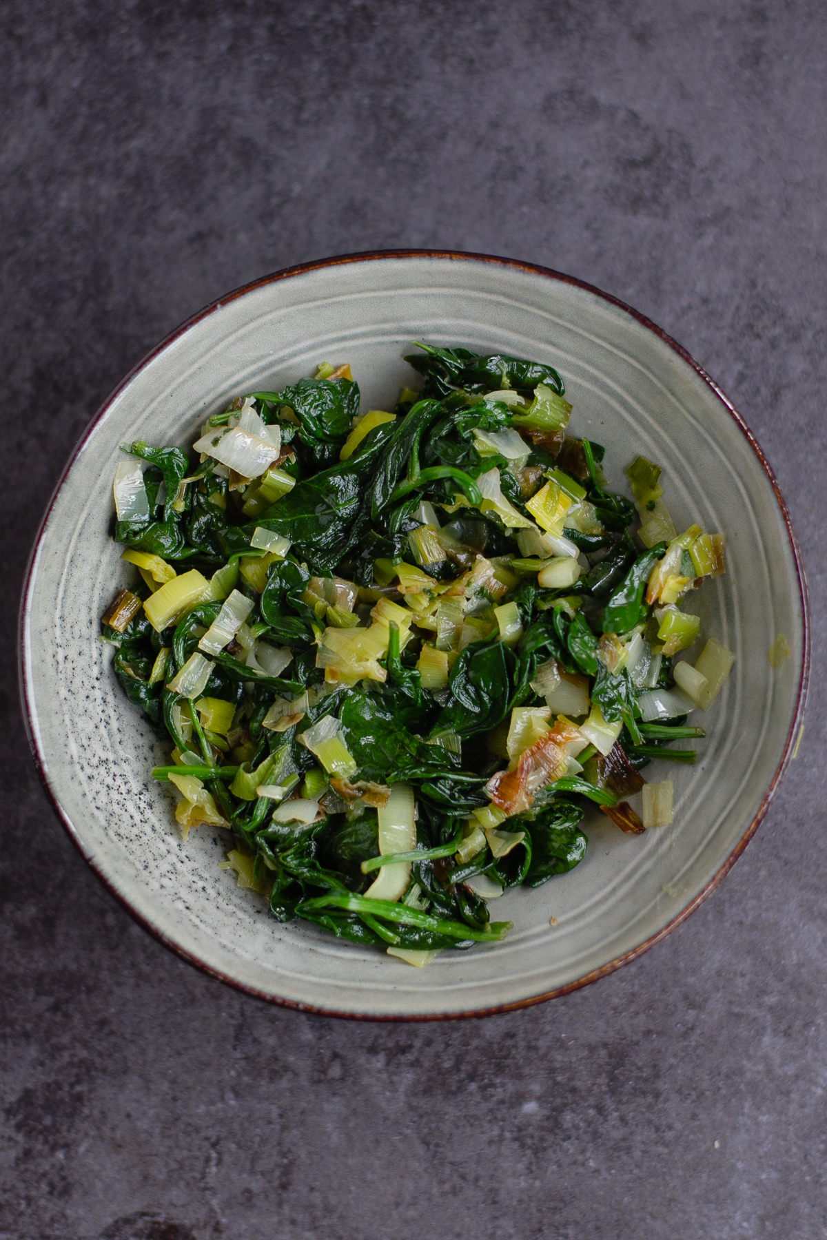 the leek and spinach mixture in a bowl for a vegan pide filling