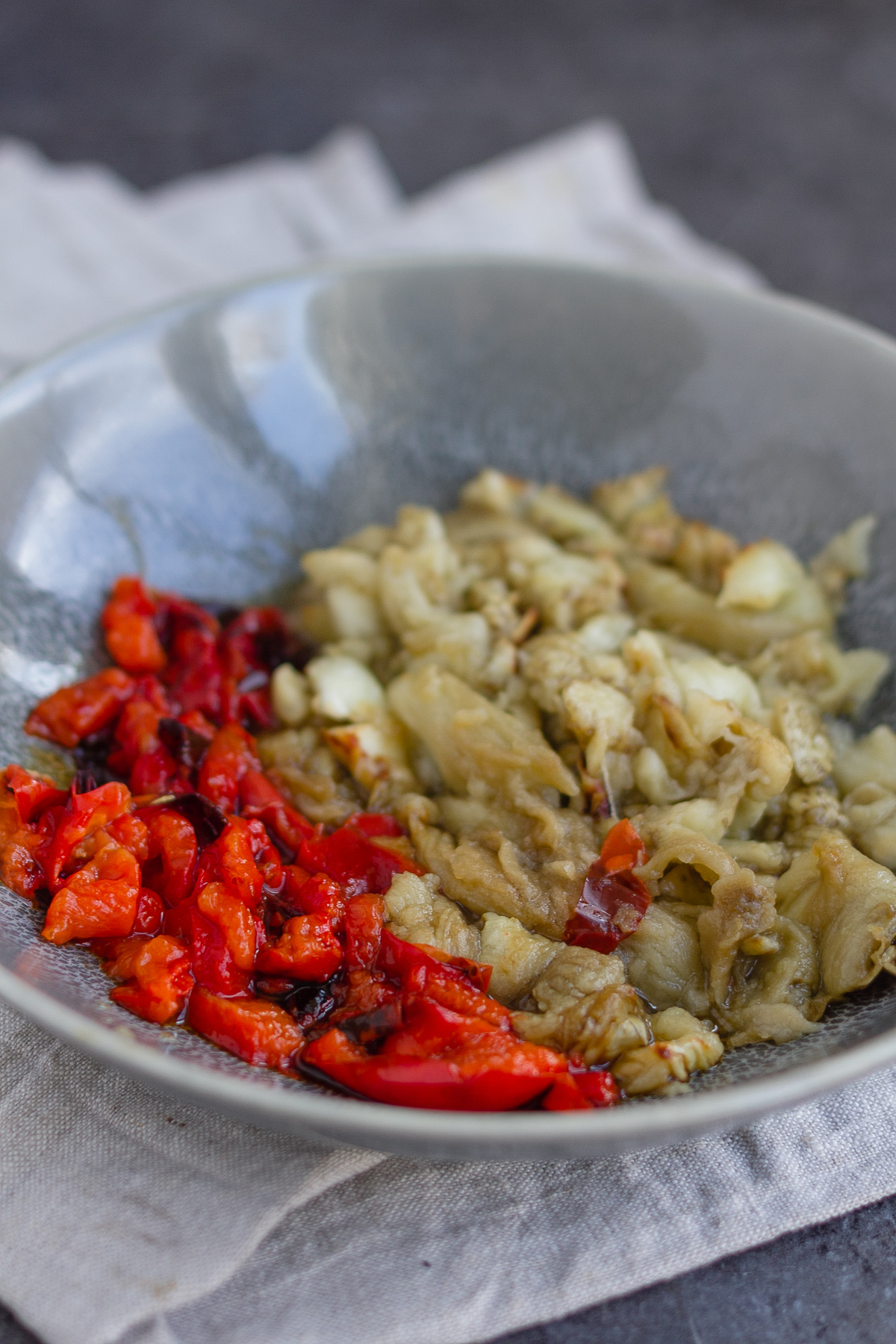 bowl with chopped roasted red pepper and aubergine eggplant