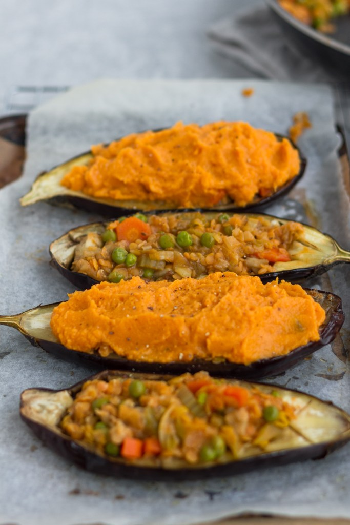 stuffed aubergine with lentil shepherds pie filling and topped with sweet potato mash
