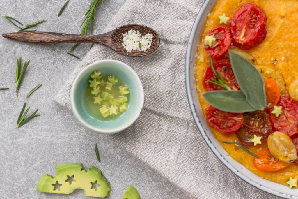 herby butternut squash polenta topped with roasted tomatoes and avocado