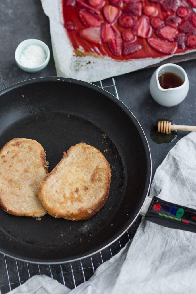 orange vegan french toast with maple glazed strawberries