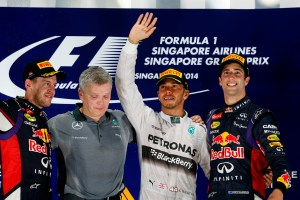 Marina Bay Circuit, Singapore. Sunday 21 September 2014. Lewis Hamilton, Mercedes AMG, Sebastian Vettel, Red Bull Racing, and Daniel Ricciardo, Red Bull Racing, on the podium. World Copyright: Charles Coates/LAT Photographic. ref: Digital Image _J5R9767