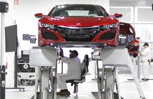 Carl Mason sits in the aligner chair during the wheel alignment