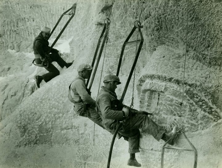 Mount-Rushmore-construction-workers-hanging-by-cables