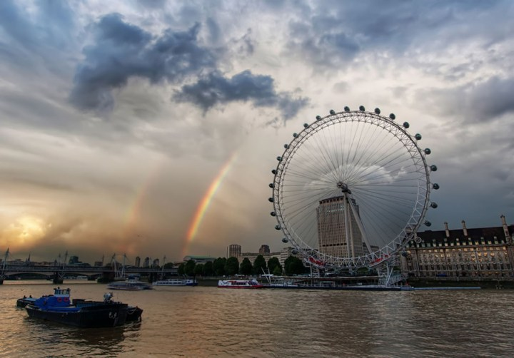 "Double rainbow over the London Eye. Accuweather wrote, ""Nature's natural color spectrum always elicits the same pattern (red, orange, yellow, green, blue, indigo, violet) when light is refracted. While a primary rainbow is visible when light is reflected once off the back of a raindrop, a secondary and usually dimmer rainbow is spotted when light is reflected twice in a more complicated pattern. The colors of the second rainbow are inverted, with blue on the outside and red moved to the inside. The second bow appears dimmer or cloudier because much more light is released from two reflections, and both bows cover a larger portion of the sky. It is rare and unlikely, but three or even four rainbows can be seen on occasion, but only if they are reflected off of the earthly objects."" Photo #10 by Trey Ratcliff"
