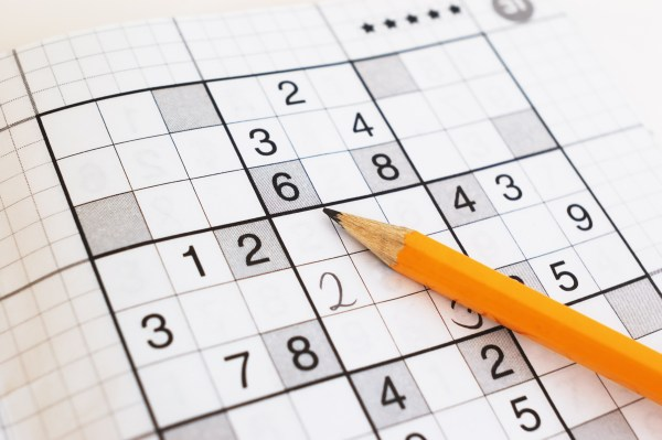 close-up-of-sudoku-game-and-yellow-pencil-focus-on-a-pencil-1