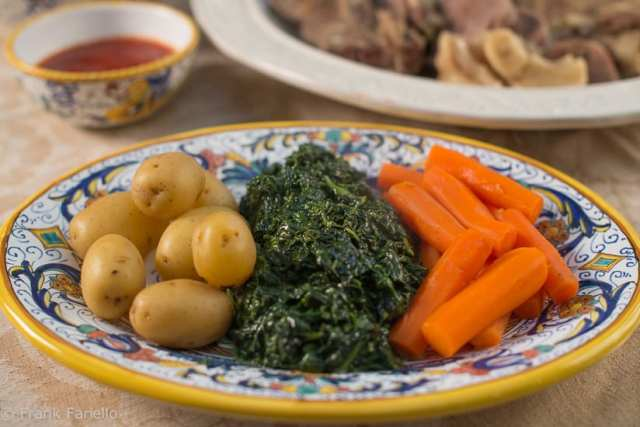 Boiled potatoes, creamed spinach and boiled carrots.