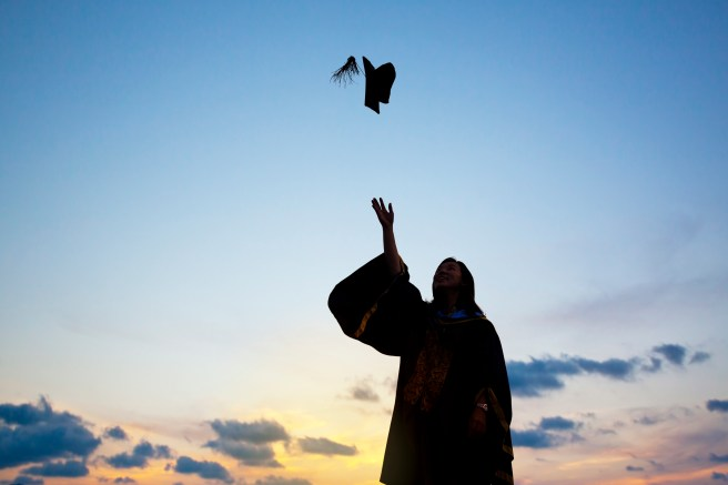 graphicstock-silhouette-of-young-female-student-celebrating-graduation_ruxbuG3weix.jpg