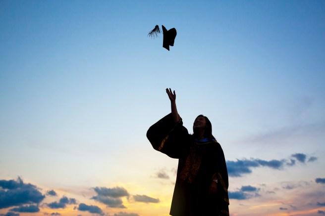 graphicstock-silhouette-of-young-female-student-celebrating-graduation_ruxbuG3weix.jpg