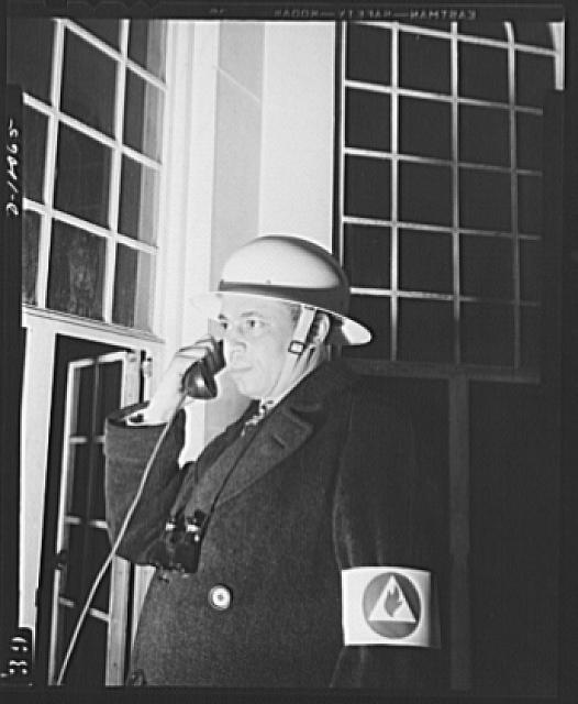 Office of Civilian Defense workers help protect nations capital. Ever on the alert is the fire watcher, who mounts to his high vantage point at the first alarm. He is responsible for detecting incendiary fires, contacting his organization promptly so that such fires may be quickly extinguished.  April 1943.