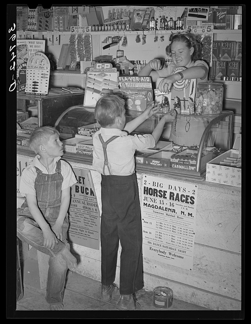 Farm children buying candy at the general store.  June 1940